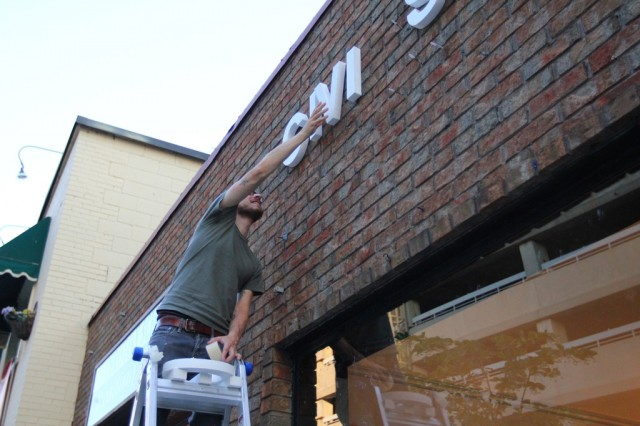 Installing some signage on the exterior wall of CIVIC SPACE (2)